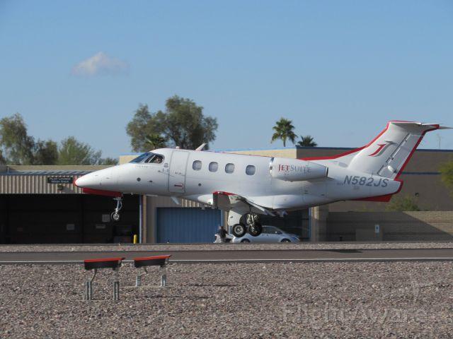 Embraer Phenom 100 (N582JS) - N582JS, JetSuite's Embraer Phenom 100, lands on Runway 21 at Scottsdale.