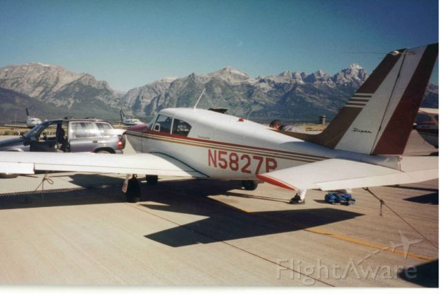 Piper PA-24 Comanche (N5827P) - In Jackson Hole Airport with Tetons in background