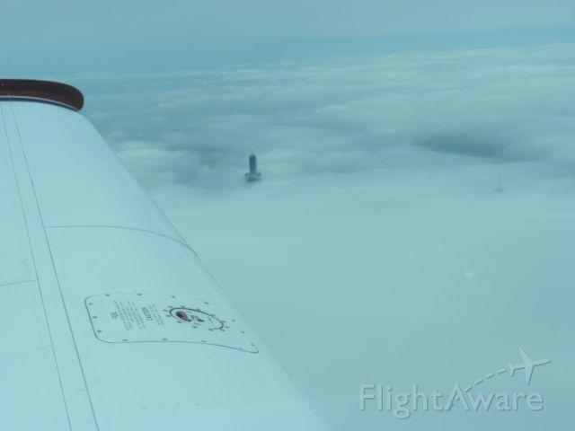 Beechcraft Bonanza (33) (N1854X) - Northbound along Lake Michigan shoreline near Chicago; Willis (Sears) Tower through the overcast.