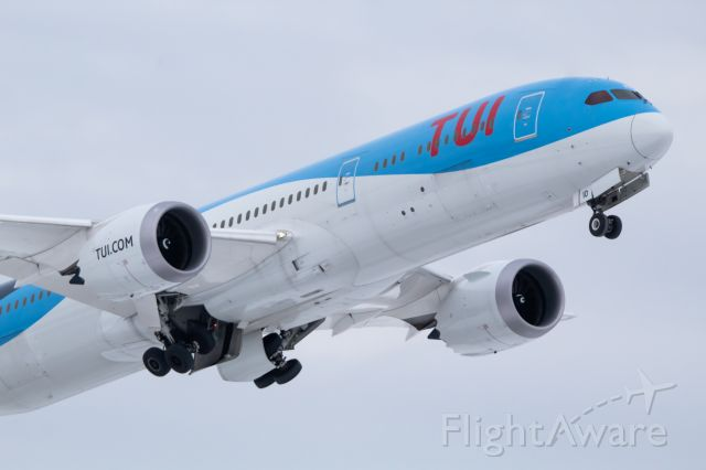 Boeing 787-9 Dreamliner (G-TUIO) - Tui UK taking off 21R after bringing in a shipment of car parts for GM from Stuttgart Germany.