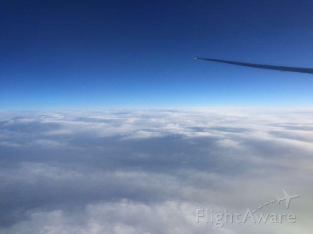 — — - Flying above Nebraska.