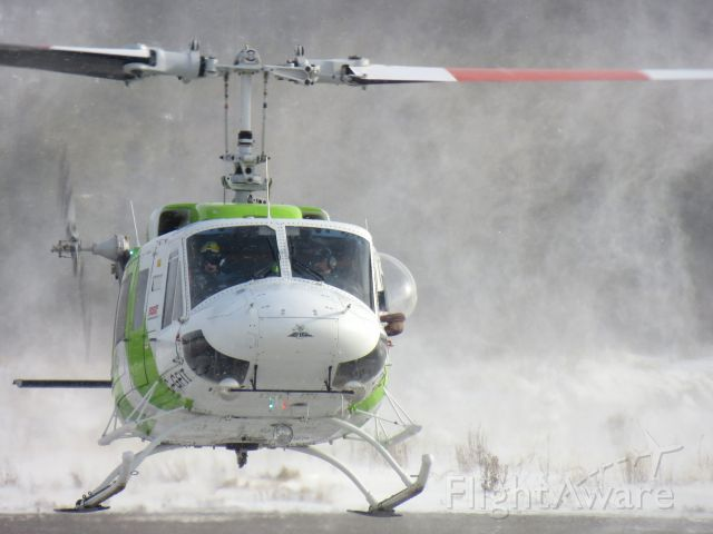 Bell BigLifter (C-GFIT) - C-GFIT, an Heli-Excel Bell 214 clearing the snow off the helipad. Poste-Montagnais, Québec - November 2012