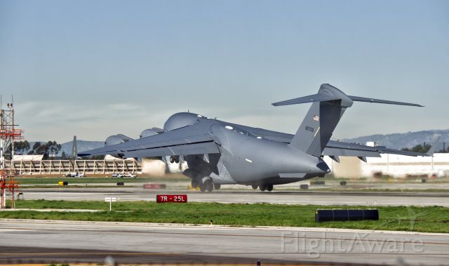 """Boeing Globemaster III (N271ZD) - Wheels barely off of the ground and kicking up dust...br /A """"white tail"""" Boeing C-17 Globemaster III takes off on its maiden test flight from the Boeing Factory in Long Beach, CA at KLGB"""