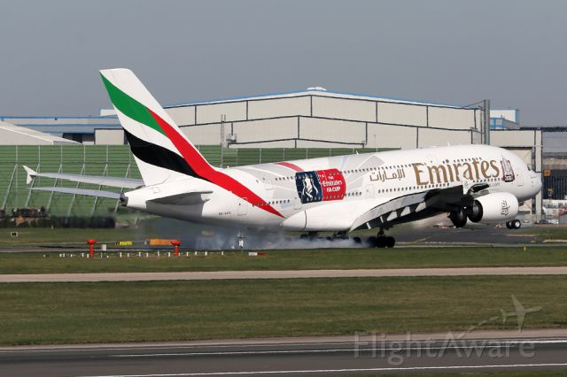 Airbus A380-800 (A6-EES) - UAE17 touches down with a cloud of wheel smoke