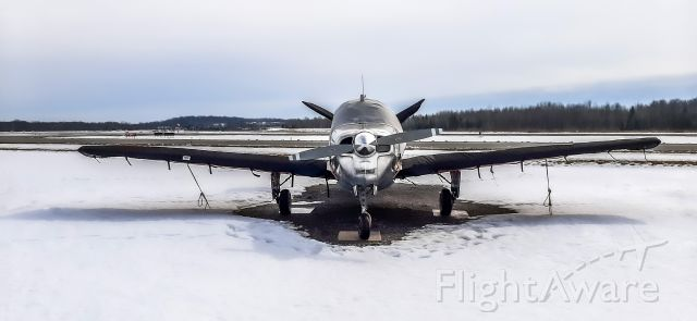 C-GNIN — - This 1947 Beech 35 (C-GNIN) seemed happy to see me as it sat alone on the freezing tarmac. Photo taken at Peterborough airport (CYPQ), Ontario, Canada