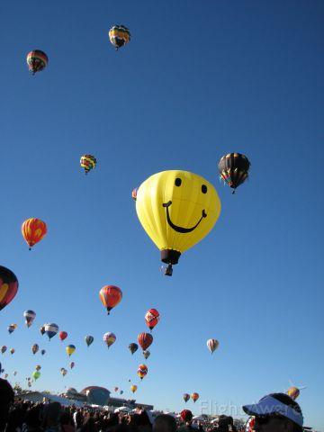 — — - 2014 Albuquerque International Balloon Fiesta. Anderson Abruzzo International Balloon Museum in the background. October 4, 2014.