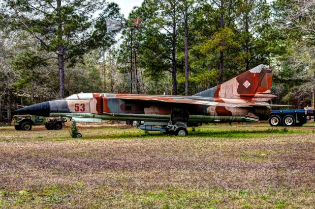 """MIKOYAN MiG-27 Bahadur — - A Russian MiG-27 Flogger sits in a very unlikely place-in a yard outside of Baker, Florida.<br />Google Earth coordinates - 30.754891, -86.696767<br />30°45'17.6""""N 86°41'48.4""""W"""