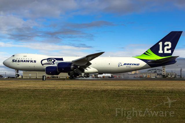 BOEING 747-8 (N770BA) - Boeing shows off Seattle Seahawks Superbowl run pride by painting N770BA in team colors.