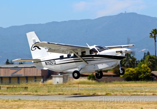 """Quest Kodiak (N112KQ) - Rare visitor departing with the infamous Mt Umunhum in the background. Note the square """"box"""" on top of the Mountian. It"""