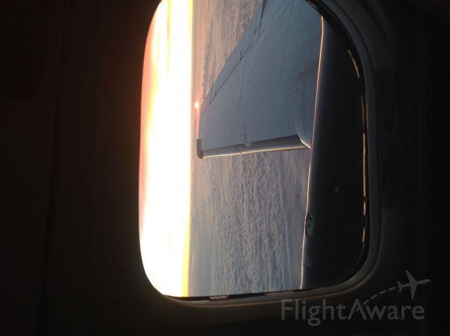 Beechcraft King Air 90 — - Sunrise under clouds.