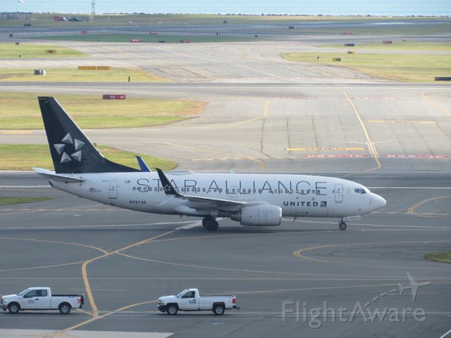 Boeing 737-700 (N13720) - Star Alliance taxis to gate B31