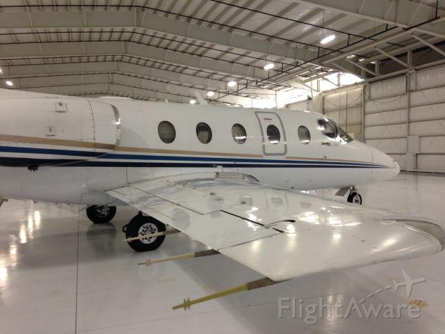 Beechcraft Beechjet — - Beechjet in a warm hangar at EKM, awaiting the next trip!