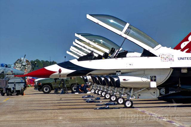 Lockheed F-16 Fighting Falcon — - The U.S. Thunderbirds aircraft sit lined up on the ramp at Tyndall AFB.