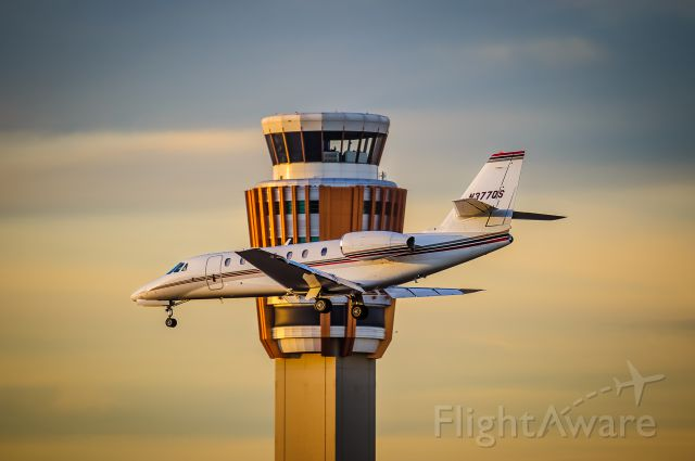 Cessna Citation Sovereign (N377QS) - A NetJets Cessna Citation Sovereign descends past the tower to Runway 25L at Phoenixs Sky Harbor International Airport.br /br /© Bo Ryan Photography