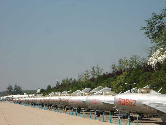 — — - Line up of MiG 15, leading to Chairman Maos airliner, Chinese Aviation Museum.
