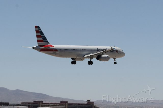 Airbus A321 (N553UW) - Final approach in the hot summer sun of the Nevada desert.