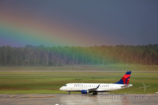 Embraer 170/175 (N879RW) - Delta Connection Operated by Republic Airways Flight 6081 from Boston taxis to the gate as a storm passes over the field on September 21st, 2018.
