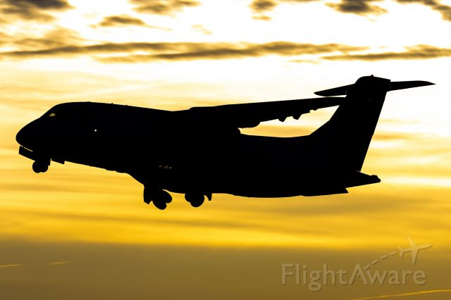"Fairchild Dornier 328JET (N359SK) - ""Dork Jet"" launching into the sunset with U Michigan's basketball team onboard."