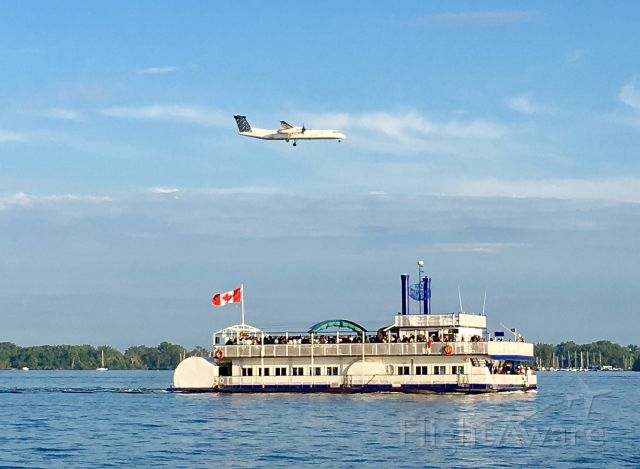 de Havilland Dash 8-200 — - Landing at City Centre.