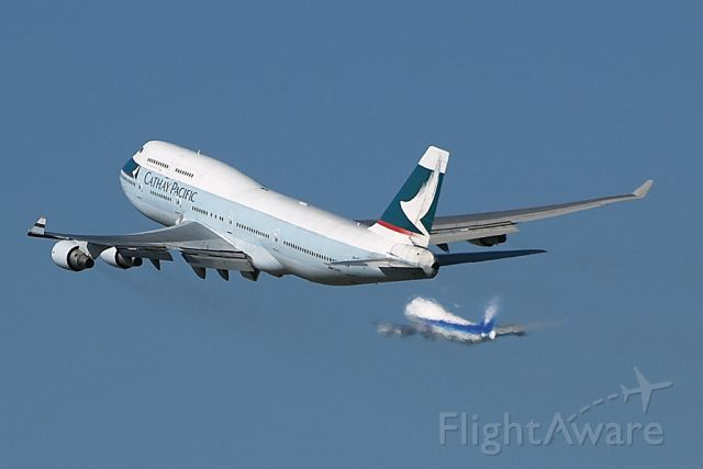 — — - Cathay Pacific departing off 25R, ANA departing off of 24L, you have to love LAX!