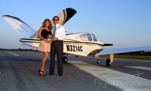 "Beechcraft 35 Bonanza (N3214C) - Jeff & Suzette Deaton & N3214C ""Charlie""  Sun-n-Fun and Oshkosh Linbergh award winner and Grand Champion"