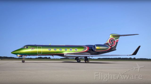 """Gulfstream Aerospace Gulfstream V (N888XY) - The two-tone aesthetic of the project used two primary paint systems: Sherwin Williams satin black base with satin clear coat, and Axalta Chromalusion's """"color-changing"""" base-coat color, called """"Perfect Jade,"""" that was finished with a gloss clear coat."""