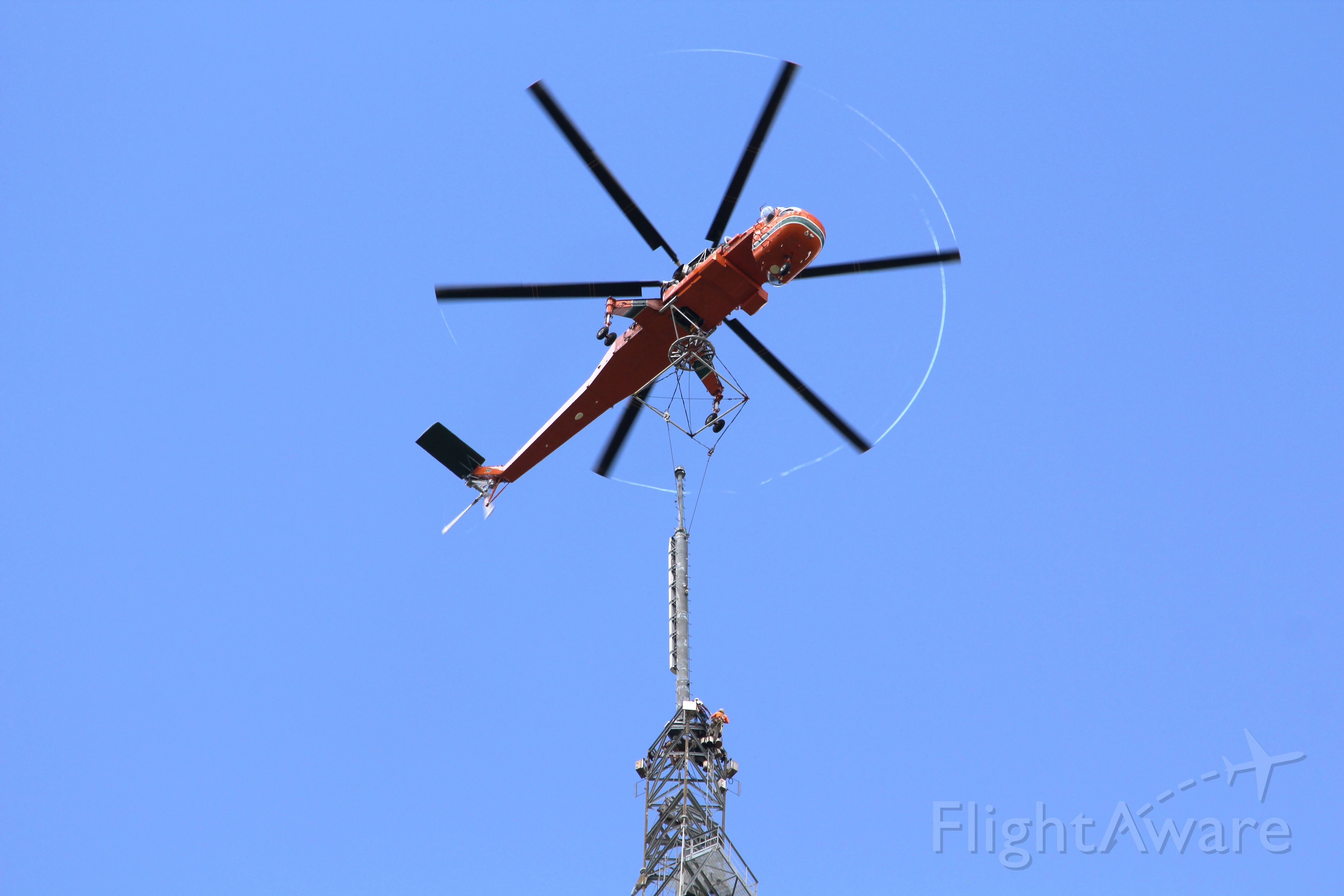 Sikorsky CH-54 Tarhe (N163AC) - This was very cool. We had the Air Crane lift our new UHF TV antenna to the top of our 1868 ft tall tower near Orlando FL. You can see the vapor trails streaming from the blade tips. The antenna weighed 14,000 lbs.
