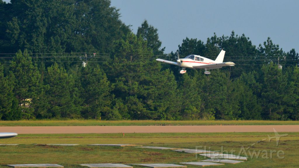 Piper Cherokee (N5700W) - Landing at its new home in Starkville, MS.