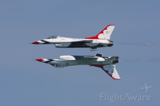— — - The Thunderbirds flying mirror image at the Ocean City Air Show in Ocean City Maryland on June 9, 2012.