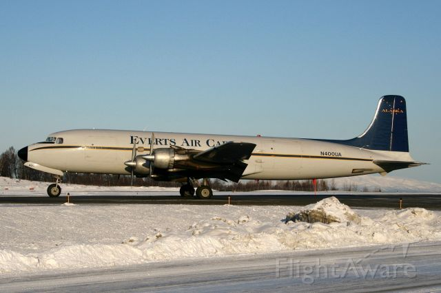 Douglas DC-6 (N400UA) - Mainliner DC-6 Freighter on Romeo at Sierra, taxi for departure rwy 32,  02Mar09