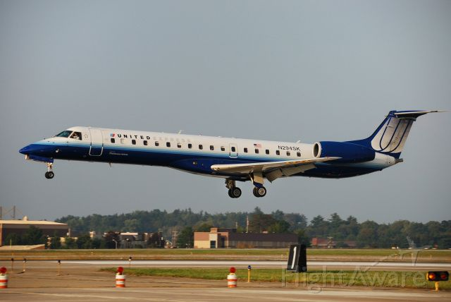 Embraer ERJ-145 (N294SK) - The Captain is shielding his eyes from the sun.