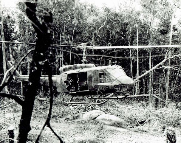 6616834 — - 119th Assault Helicopter Co. slick, Gator 834, extracting 4th Infantry Div. LRRP recon team in the Western Highlands of Vietnam, 1969.