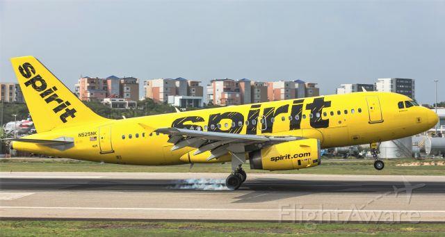 Airbus A319 (N525NK) - Spirit airlines smoking both main gears while landing at St Maarten.