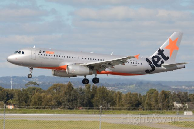 Airbus A320 (VH-VQW) - About to put down on runway 05. Thursday 7th August 2014