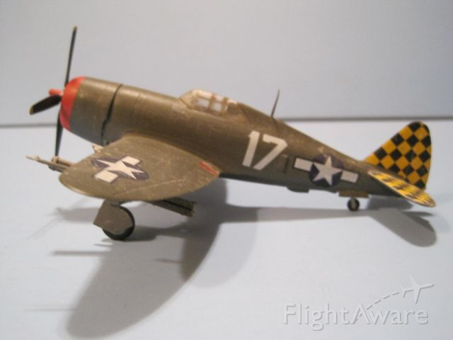"— — - 1/72 scale model of Republic P-47D ""razorback"" Thunderbolt.  Markings for 325th fighter group in Italy."