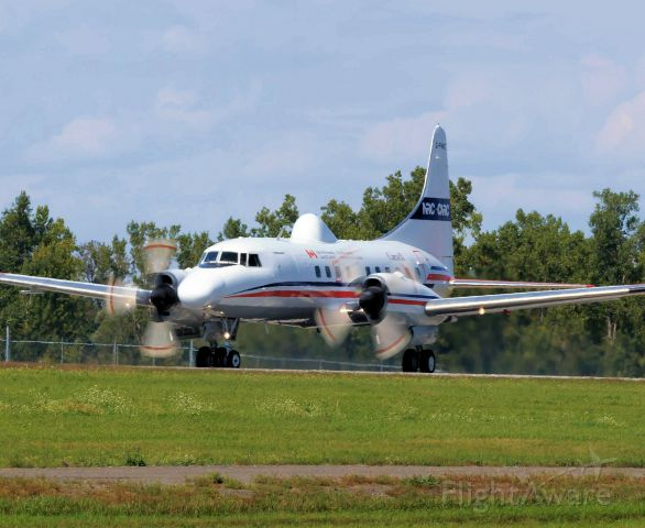 CONVAIR CV-580 (C-FNRC) - Leaving rwy 25 for a series of touch and goes.