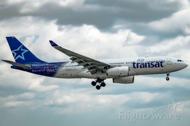 Airbus A330-200 (C-GPTS) - Here is a Air transat A330-200 on final for 23 at Toronto Pearson. Taken on August 23rd