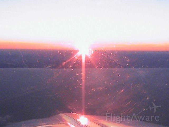 Beechcraft Bonanza (36) (N36BH) - Mi shoreline at dawn