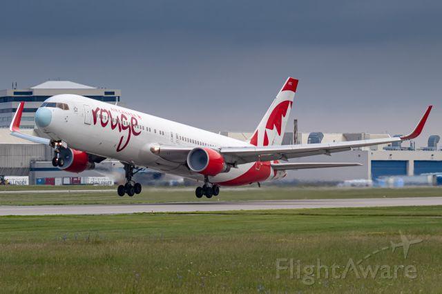 BOEING 767-300 (C-GHPN) - Rouge 1589 leaving Montreal for Edmonton.