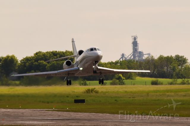 Dassault Falcon 900 (C-GNTR) - Dassault Falcon 900 departing Yorkton with the canola crushing plant in the background