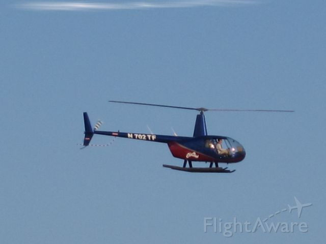 — — - This two seater helo is taking visitors around the Atlantic City Highlights shown here in the Spring of 2013.