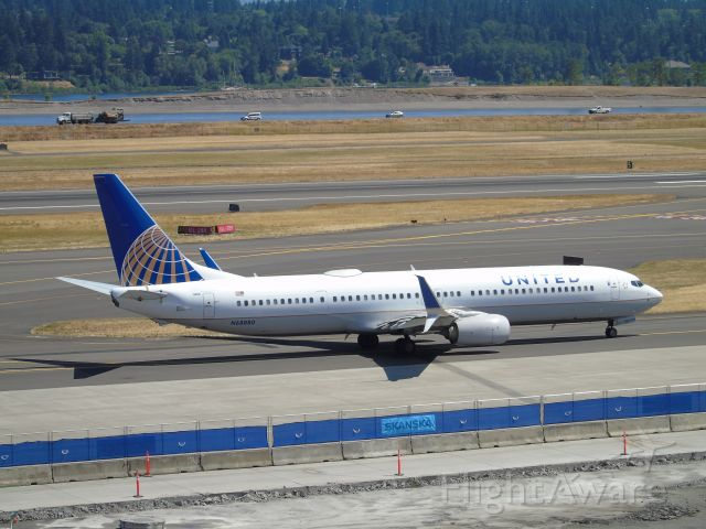 Boeing 737-900 (N68880) - From top of Short-term parking