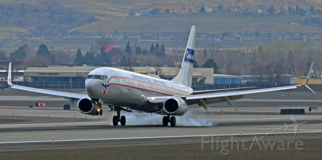 """Boeing 737-900 (N75435) - N75435, the UA B739 that wears the """"Continental Airlines"""" retro livery, is clicked here as the mains touch down on Reno Tahoe Internationals 16L a half hour before high noon to complete a short flight from SFO."""