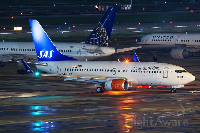Boeing 737-700 (HB-JJA) - SAS952 departing back for Stavanger.