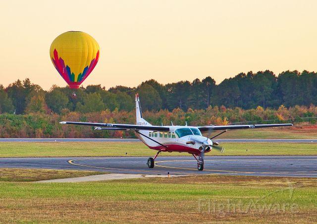 N694DA — - Caravan N694DA and Head Balloons N3121X taxying and landing.