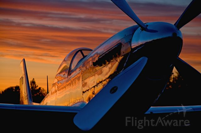 — — - Sunset reflects on highly polished P-51 Mustang