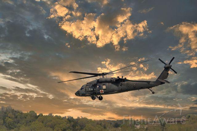 — — - UH-60 leaving KJEF