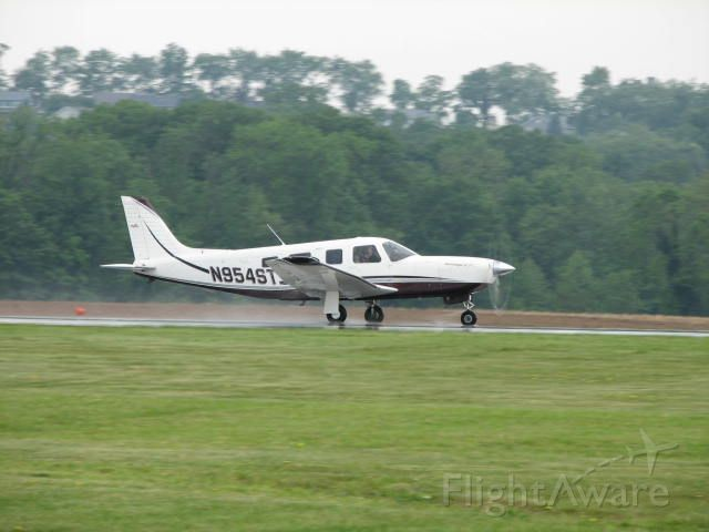 Piper Saratoga (N954ST) - Taking off on a wet runway at Selinsgrove.