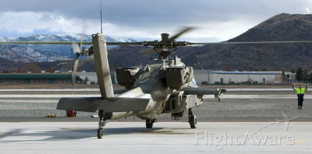 Boeing Longbow Apache (02-9027) - One of a flight of four AH-64 Apaches being marshalled to a parking position on the Atlantic Aviation ramp. One had arrived earlier in the day and three came in during this photo sequence.