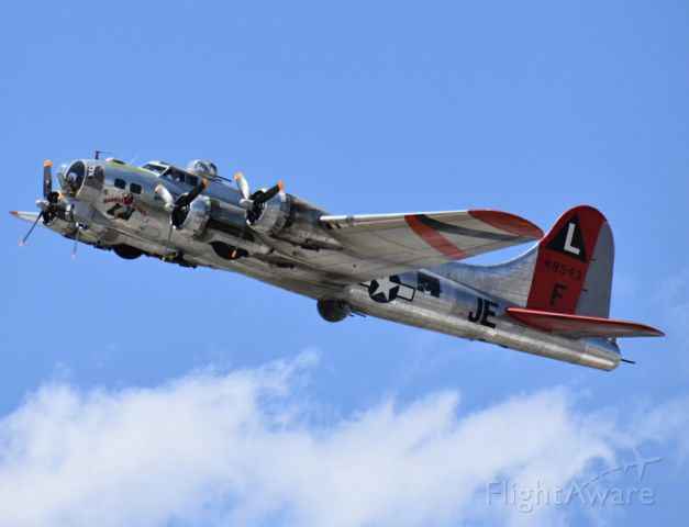 Boeing B-17 Flying Fortress (N3701G) - B-17 Madras Maiden taking off at the SLC International Airport. Photo taken from the south end of the runway just to the east of the aircraft